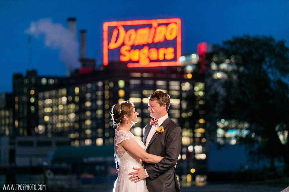 Wedding couple in front of the Domino Sugars Sign