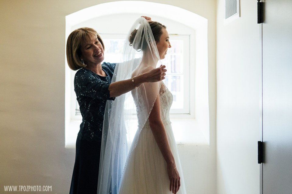 Bride and mom adjusting the veil before the wedding ceremony at the Baltimore Basilica