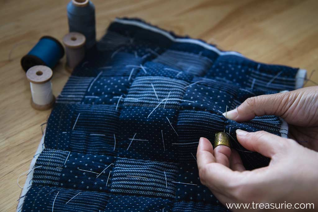 Basting a Quilt with Thread