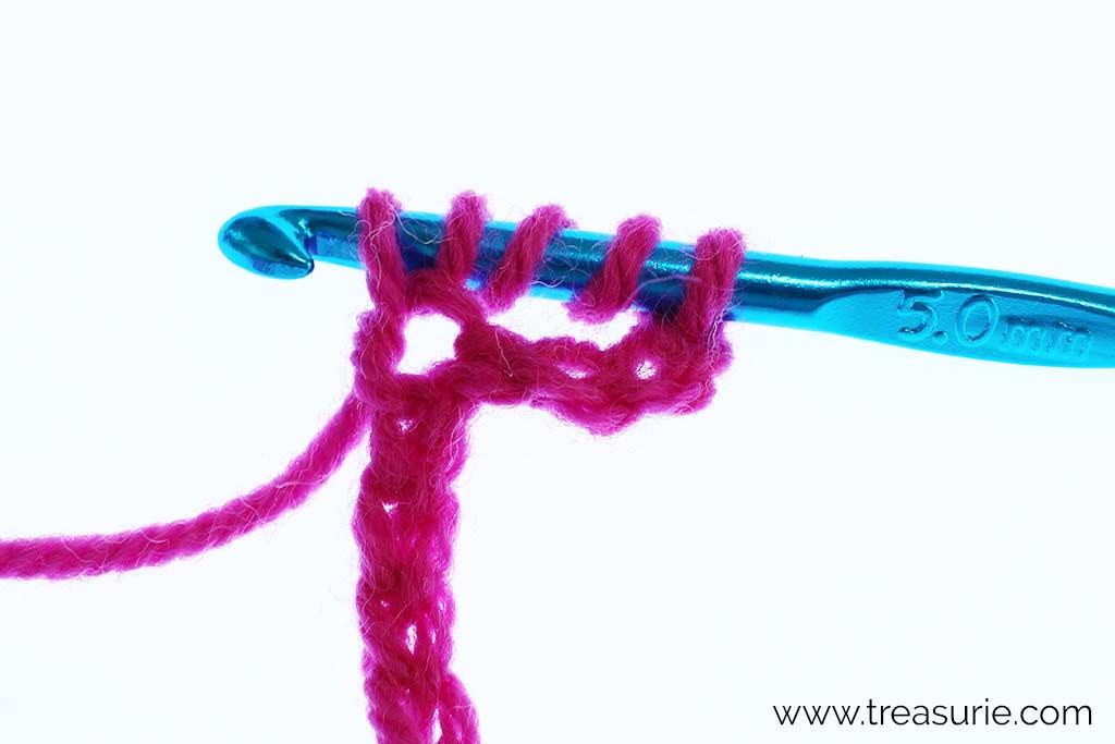Double Treble Crochet - insert hook, yo and draw through
