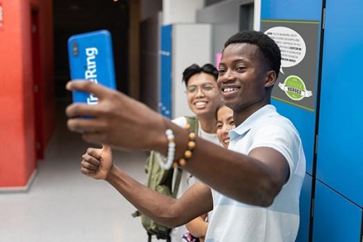 Three students take a selfie during National School  Yearbook Week