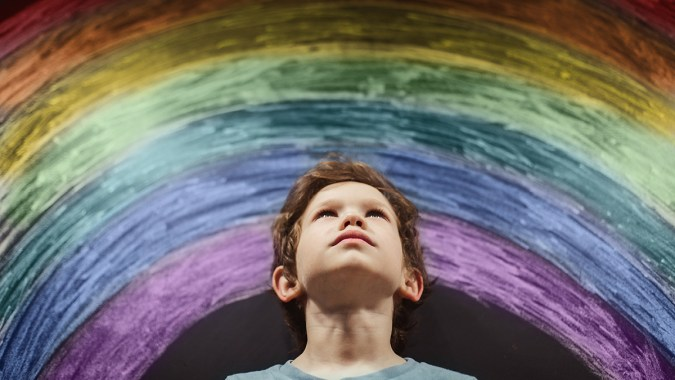 April 2 Autism Awareness Day artwork for yearbook featuring a boy and his rainbow creation