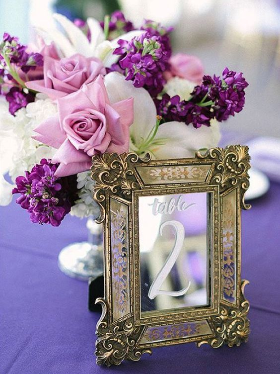 17-a-centerpiece-with-pink-roses-white-and-violet-blooms-and-a-vintage-framed-mirror