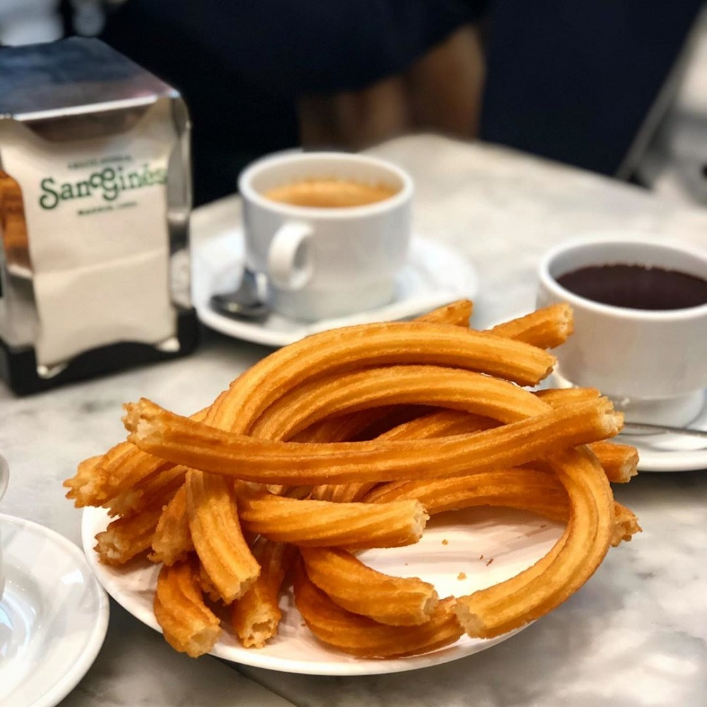 Make sure to try churros dipped in chocolate in Spain