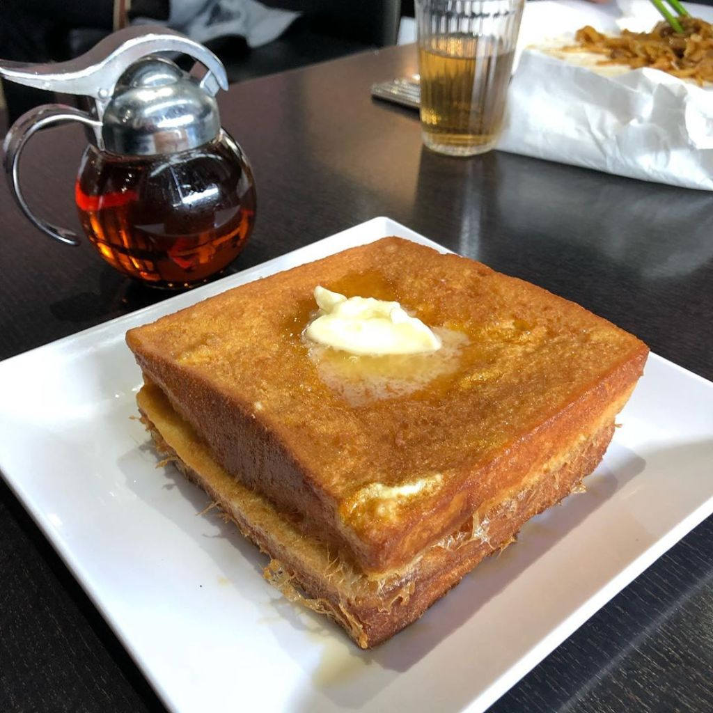 Hong Kong styled french toast has peanut butter in between it