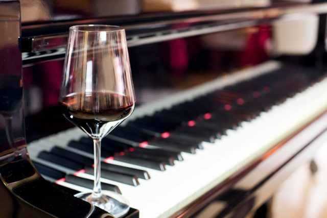 red wine glass and piano
