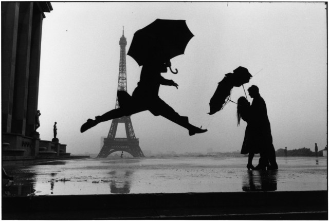 04 Elliott Erwitt, Paris, France, 1989 - Umbrella Jump, Tour Eiffel's 100th anniversary