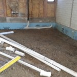 Insulation behind new sewer pipes