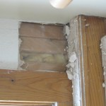 Behind the drywall