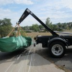 Truck's boom arm moving bagster bag