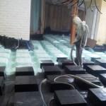 Spraying Insulstar on waffle boxes.