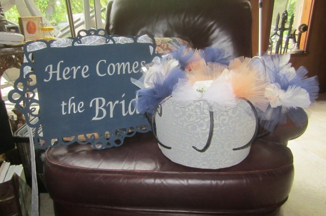 Fascinators and carry sign for grandkids