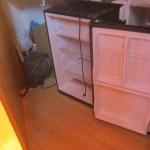 Dorm fridge in closet