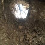 Hole bored under concrete obstruction