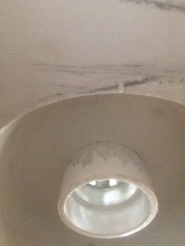 Shaved PVC pipe under tub