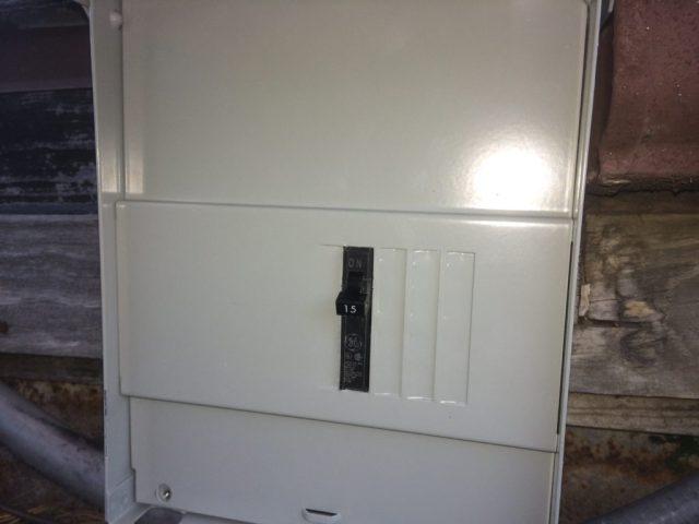 Lone circuit breaker in outside box