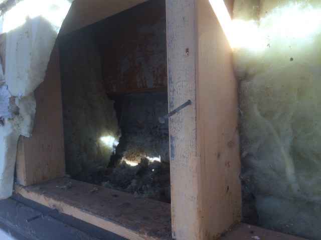 Tearing Out Old PolyIso and Fiberglass Insulation