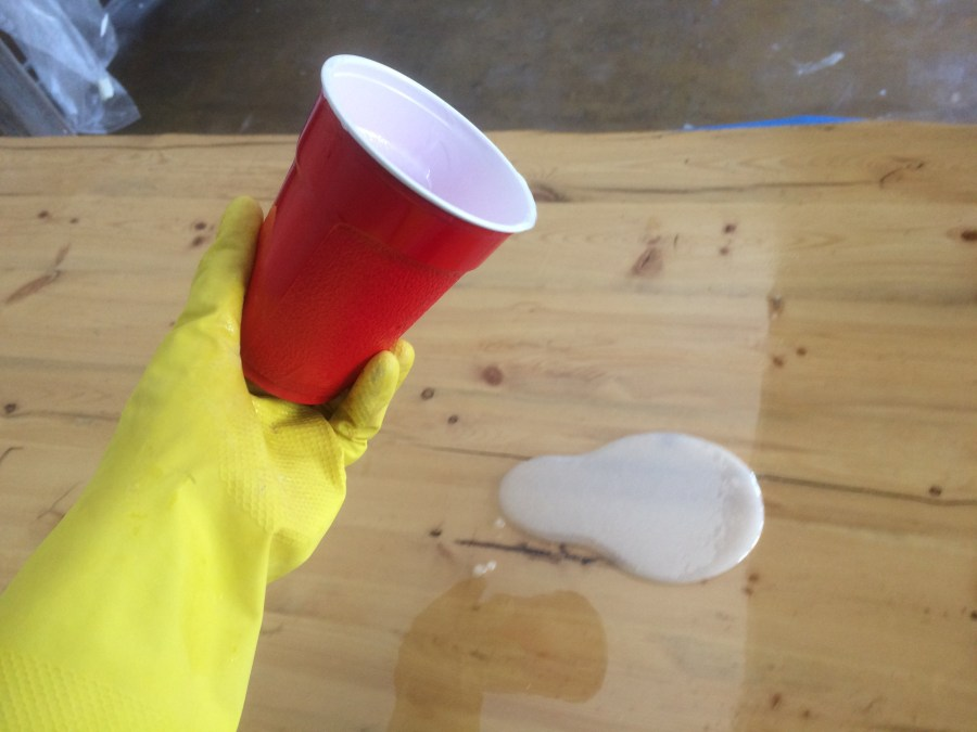 Pouring epoxy from second mix cup