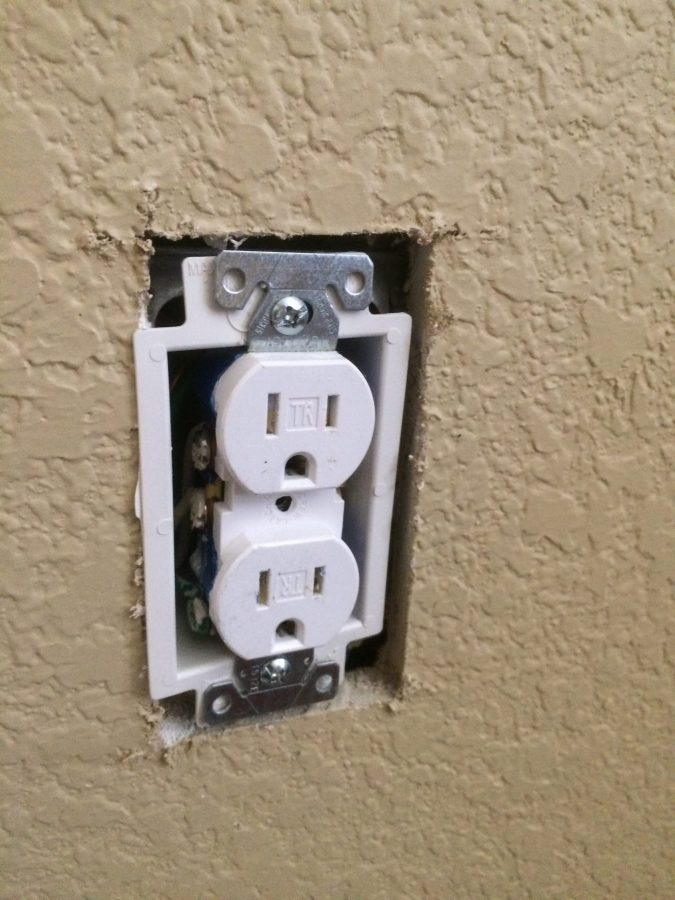 Outlet and wires pushed back