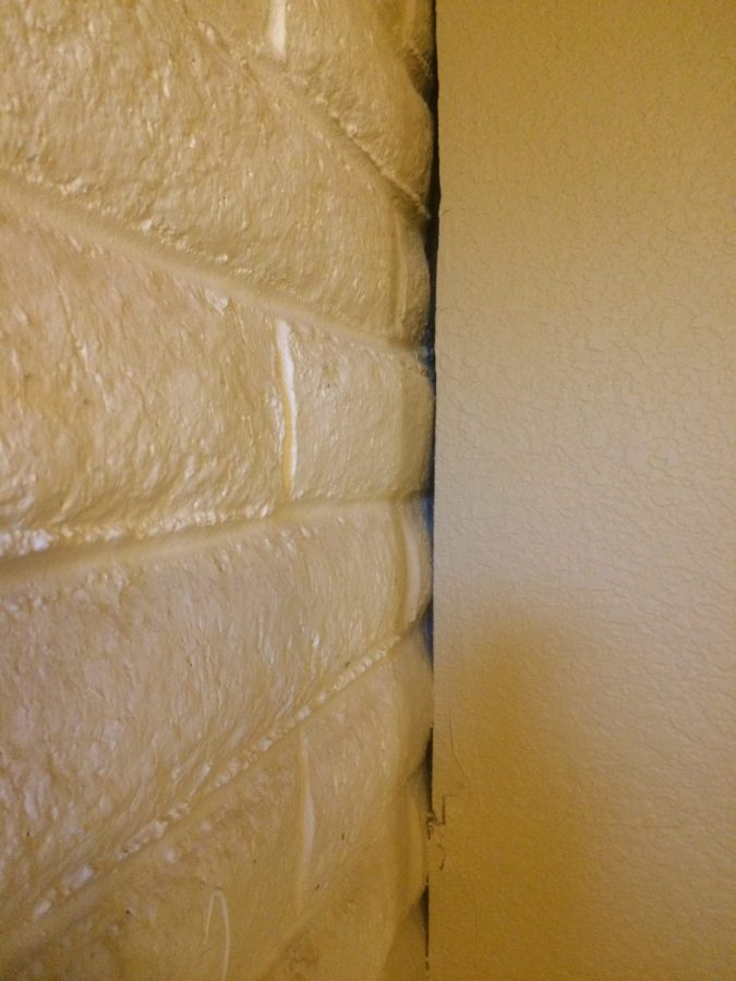 Open edge between drywall and brick