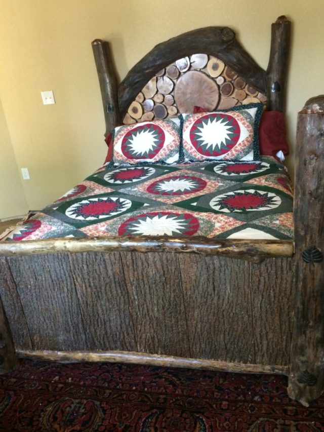 Bed made up with head and footboard