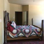 Bed on oriental carpet