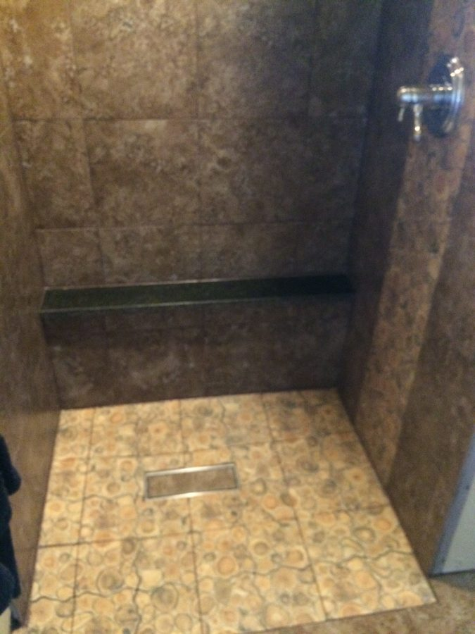 Caulked floor with mismatched tile insert
