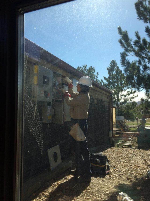 Xcel technician installing meter
