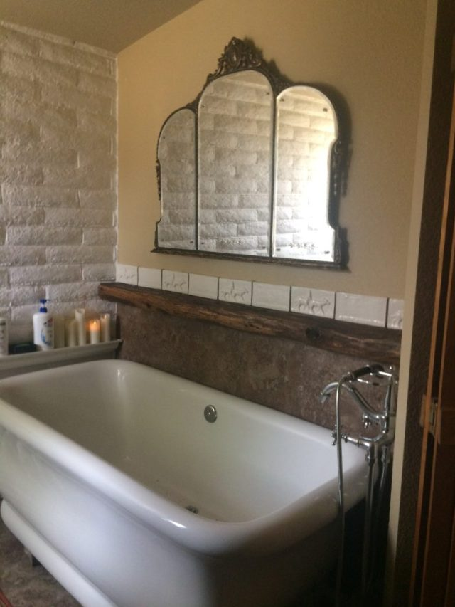 Grandmother's mirror over Victorian stele tub.