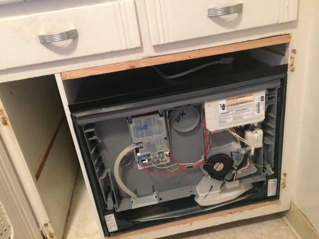 Dishwasher in cabinet