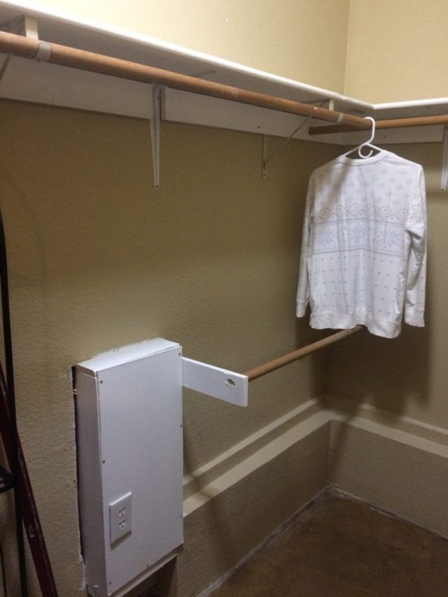Closet poles with ventilation fan duct box.