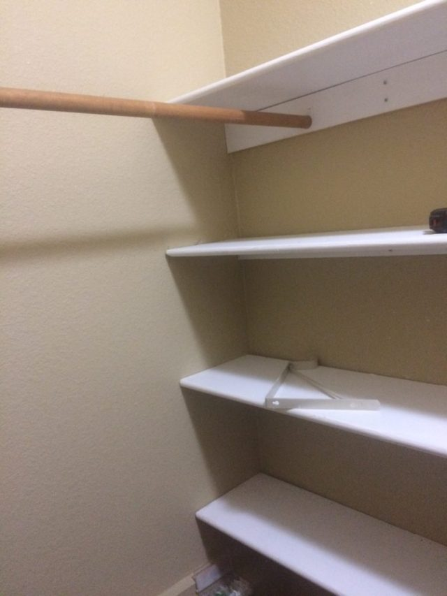 Closet pole held by support board.