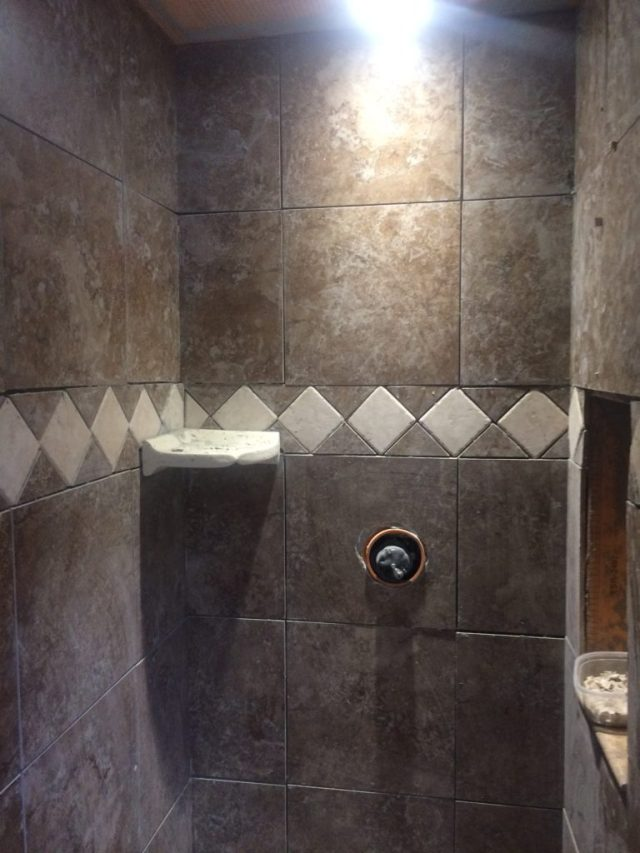 Trim tile at front of shower
