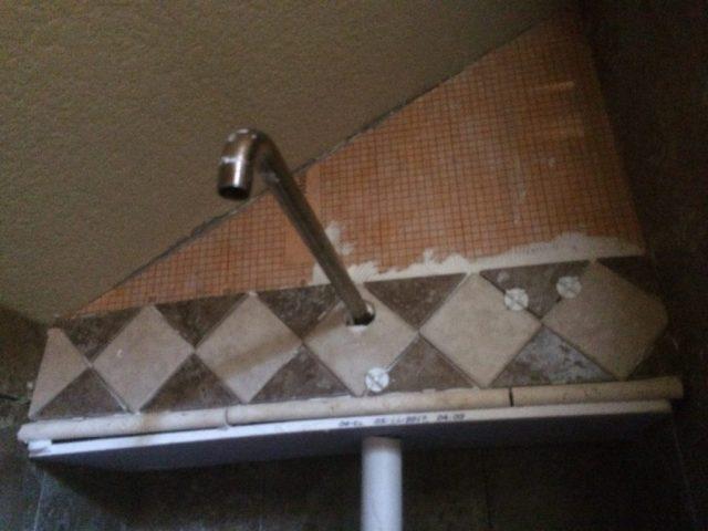 Trim tile on shower head wall