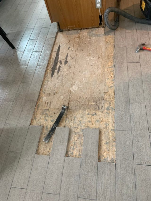 Partial tiles cut out and grout removed