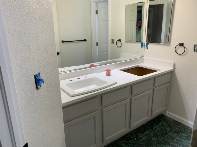 Family bath cabinet painted light gray
