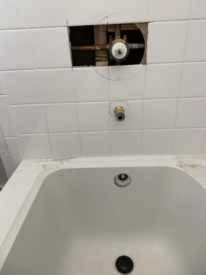 Removed tile to examine valve for new trim