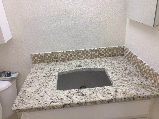 Fitting counter and backsplash