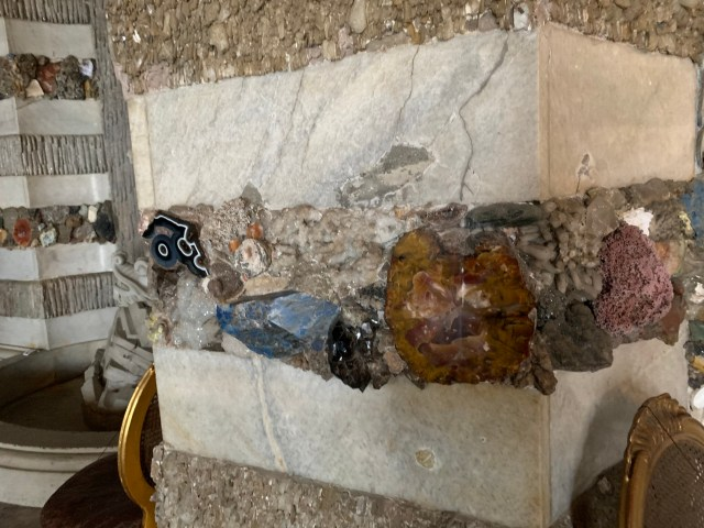 Grotto walls with bands of minerals