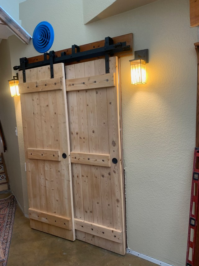 Bedroom doors with sconce lights