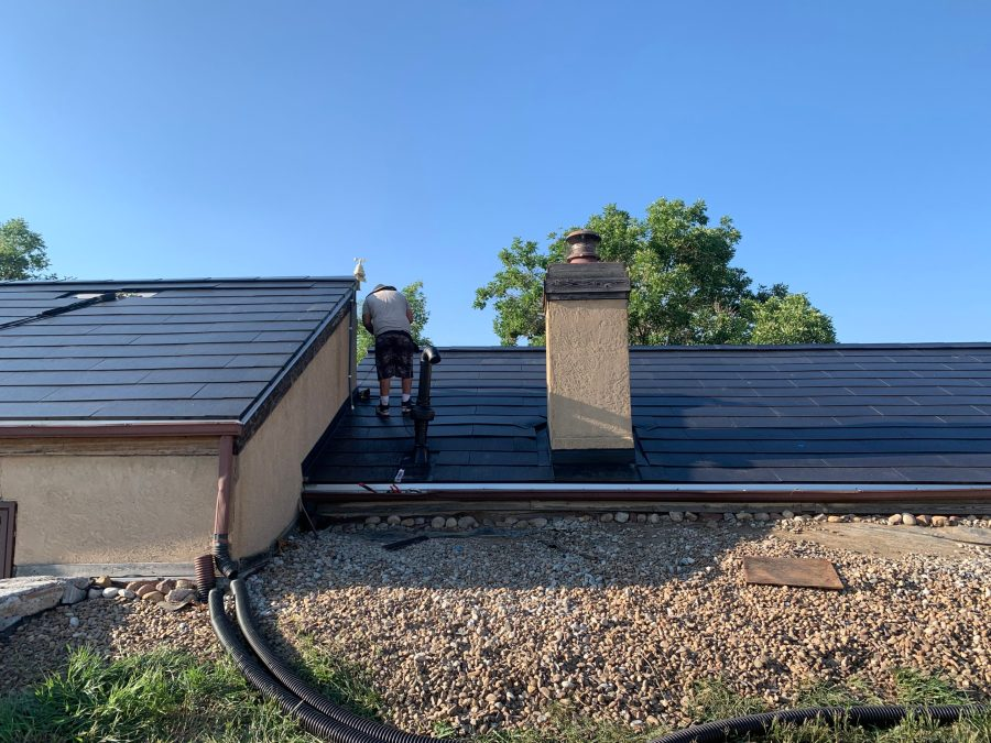 First radon fan is exterior. Painted to match roof.
