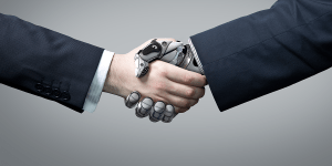 Image of a person and robot handshake