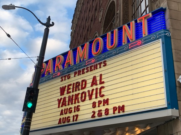 """The Paramount's marquee which reads """"STG Presents Weird Al Yankovic"""" followed by show times."""