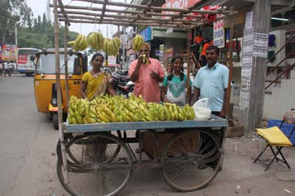 Sujatha and her husband, Joseph, (far right) sell bananas and other fruits from their puller cart.
