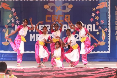 Sponsored friends in India perform a cultural dance for awareness trip travelers.