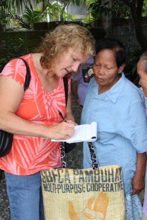 Communications editor Loretta Shea Kline interviews sponsored aging members in Agoo, Philippines.