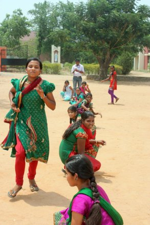 Sponsored friends in India playing a game of kho kho.