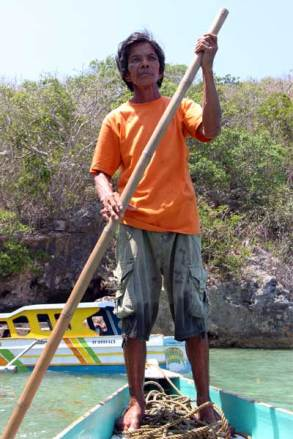 Jose pilots his boat to guide tourists.