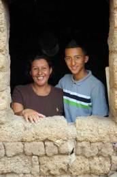 Though Esteban, from El Salvador, may be taller than his mother, Lucely, he will always be her baby boy.