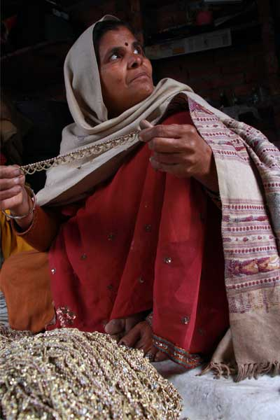 Indian mom Maan Devi makes anklets and sells them to support her children.